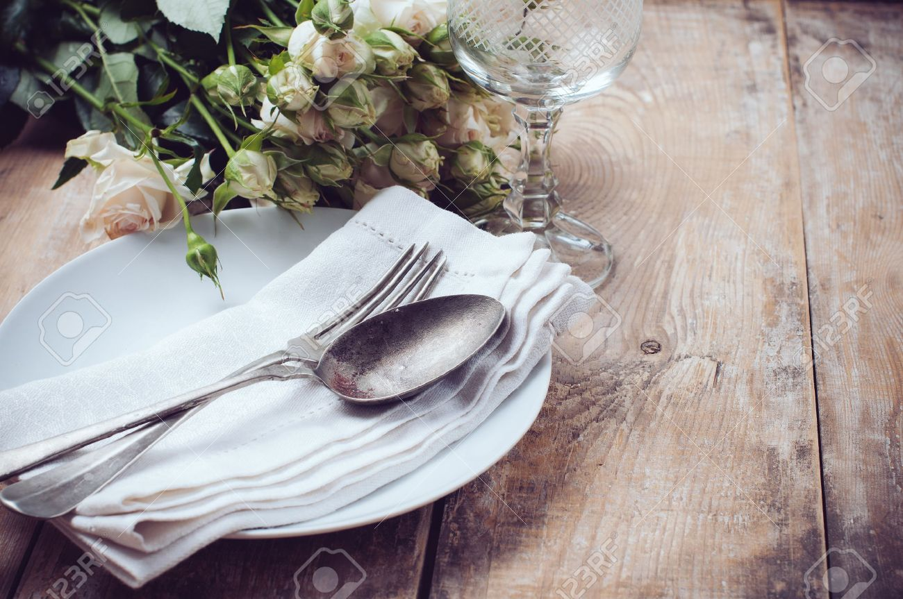 Stock Photo - Vintage table setting with roses antique rustic dishes and cutlery on the wooden background close-up & Vintage Table Setting With Roses Antique Rustic Dishes And Cutlery ...