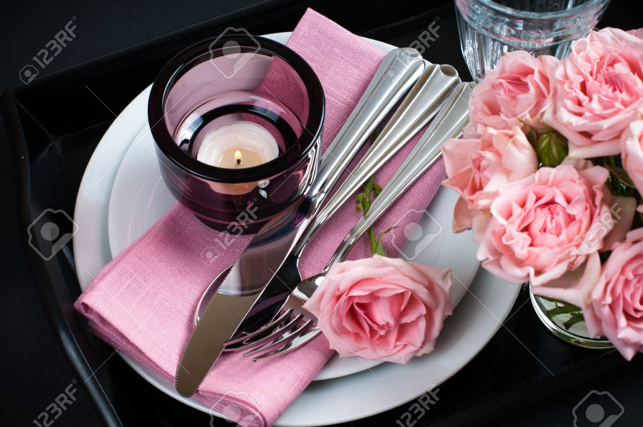 Luxury festive table setting with pink roses candles and shiny new cutlery on black background & Luxury Festive Table Setting With Pink Roses Candles And Shiny ...