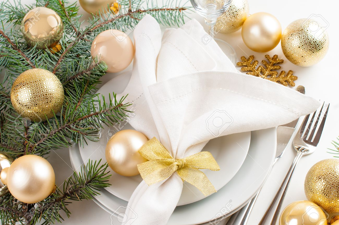 Christmas table decorations gold - Festive Christmas Table Setting Table Decorations In Gold Tones With Fir Branches Baubles
