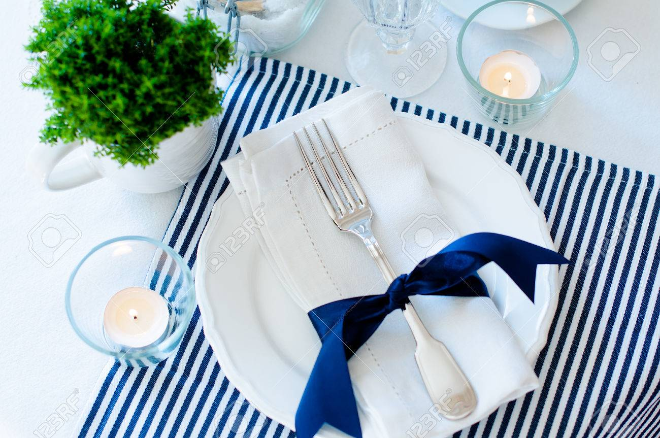 Wonderful Table Setting For Breakfast With Napkins, Cups, Plates In Navy Blue Tones  On A