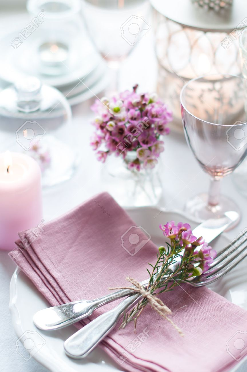 Festive wedding table setting with pink flowers napkins vintage cutlery glasses and candles & Festive Wedding Table Setting With Pink Flowers Napkins Vintage ...