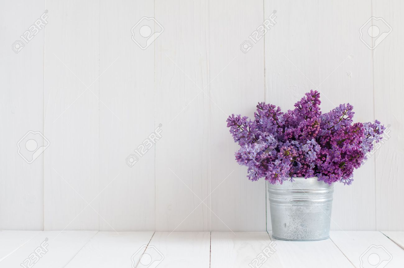 Bouquet of beautiful spring flowers of lilac in a vase on a white bouquet of beautiful spring flowers of lilac in a vase on a white vintage wooden board reviewsmspy