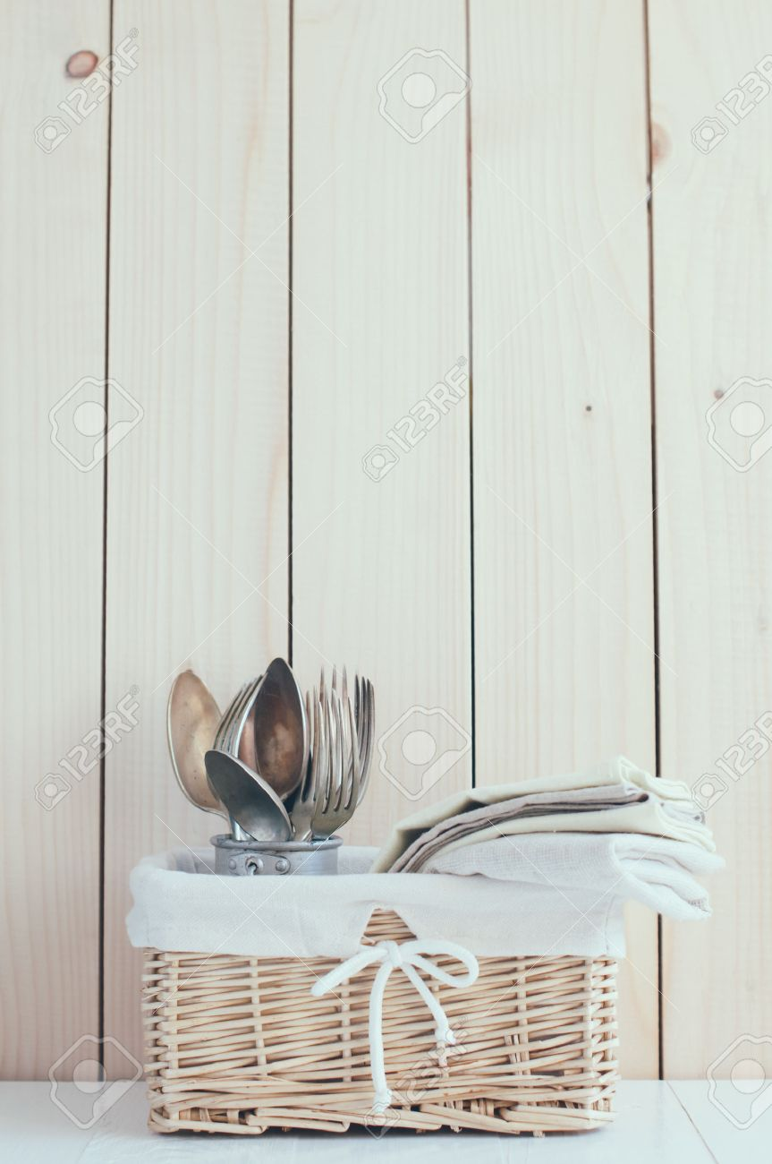 Home Decor Vintage Wicker Basket And Cutlery On A Wooden Board Background Cozy Kitchen