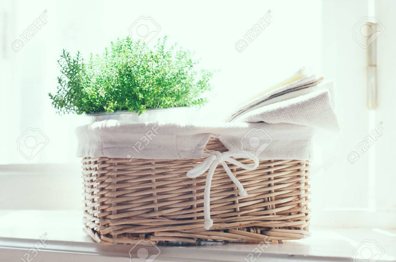 Home Decor Vintage Wicker Basket House Plant And A Stack Of Linen Napkins On