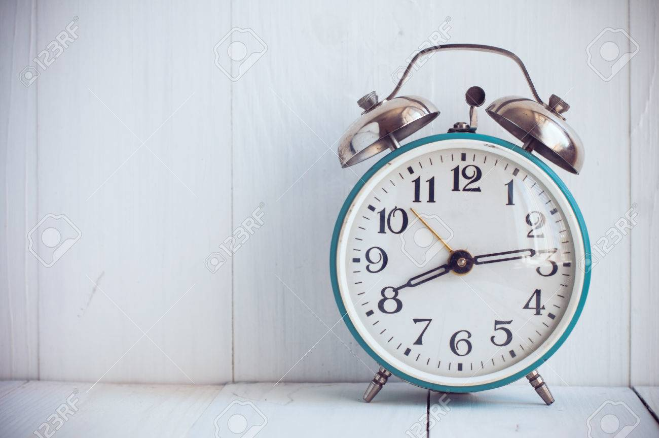 Big old vintage alarm clock with bells painted white wooden big old vintage alarm clock with bells painted white wooden background stock photo 28242485 amipublicfo Image collections