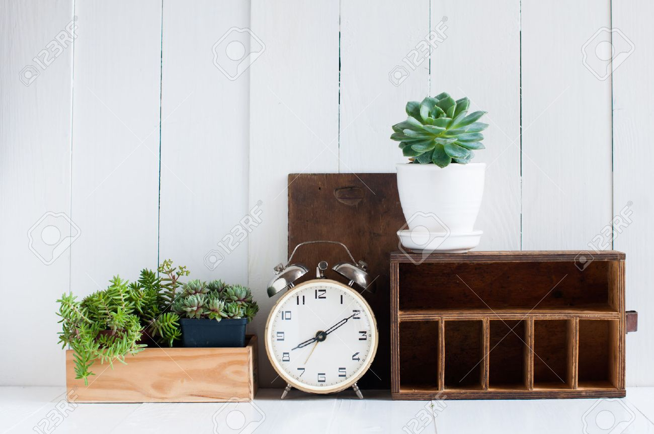 stock photo vintage home decor old wooden boxes houseplants alarm clock on white wooden board retro home interior - Retro Home Decor