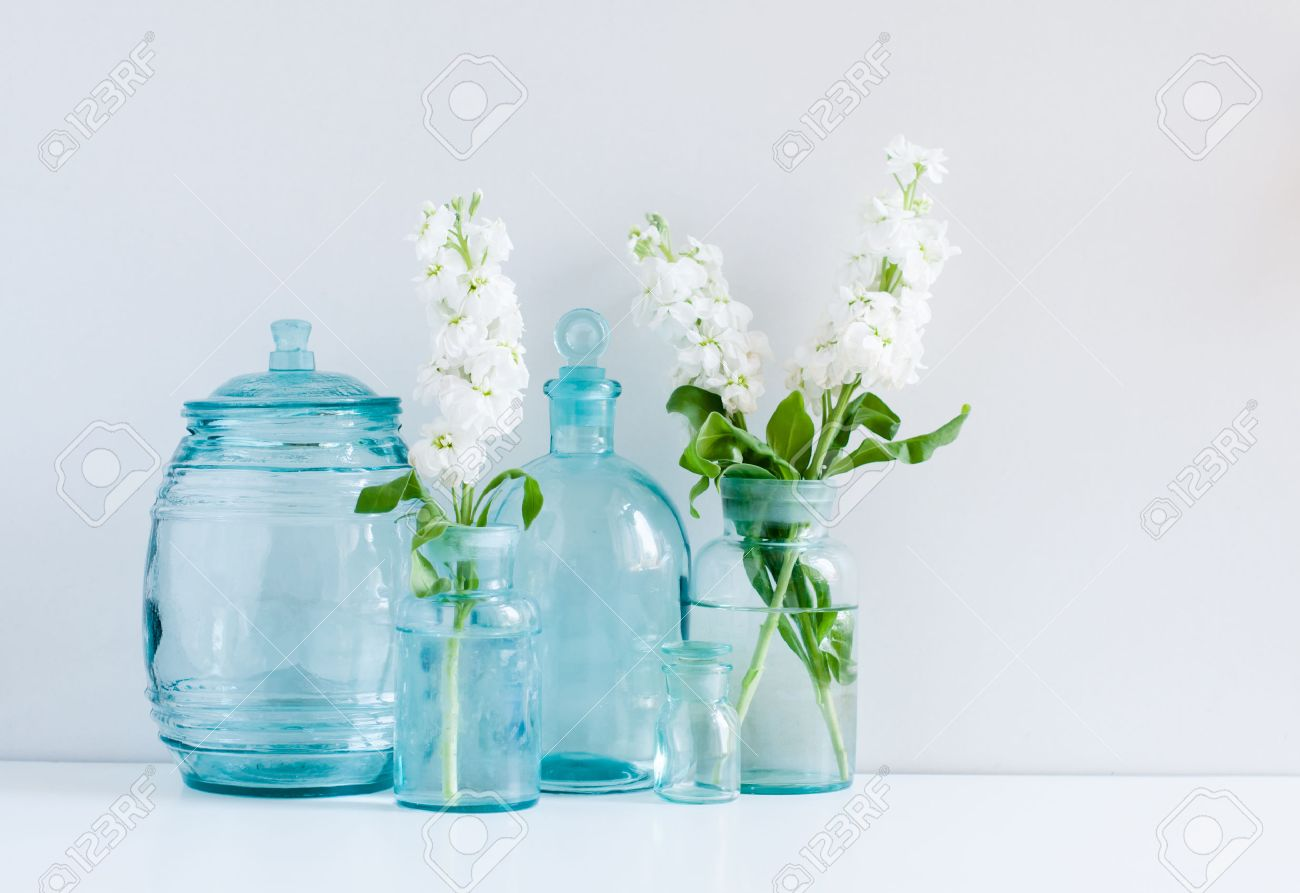 glass vase vintage home decor background white matthiola flowers in different blue glass bottles