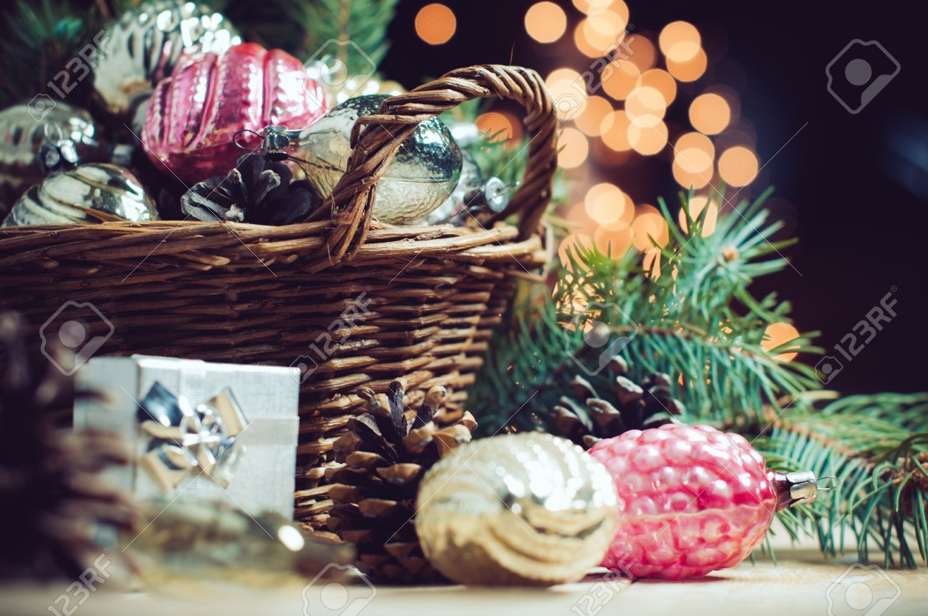Vintage looking christmas ornaments - Stock Photo Vintage Christmas Decorations In A Wicker Basket Christmas Gift In Retro Style Christmas Garlands Cozy Home Decor