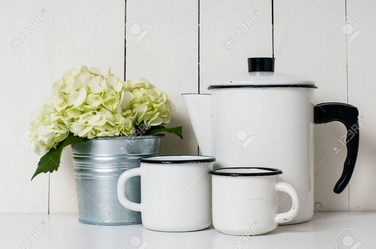 Enameled Kitchenware, Vintage Coffee Pot And Cups, And White.. Stock ...