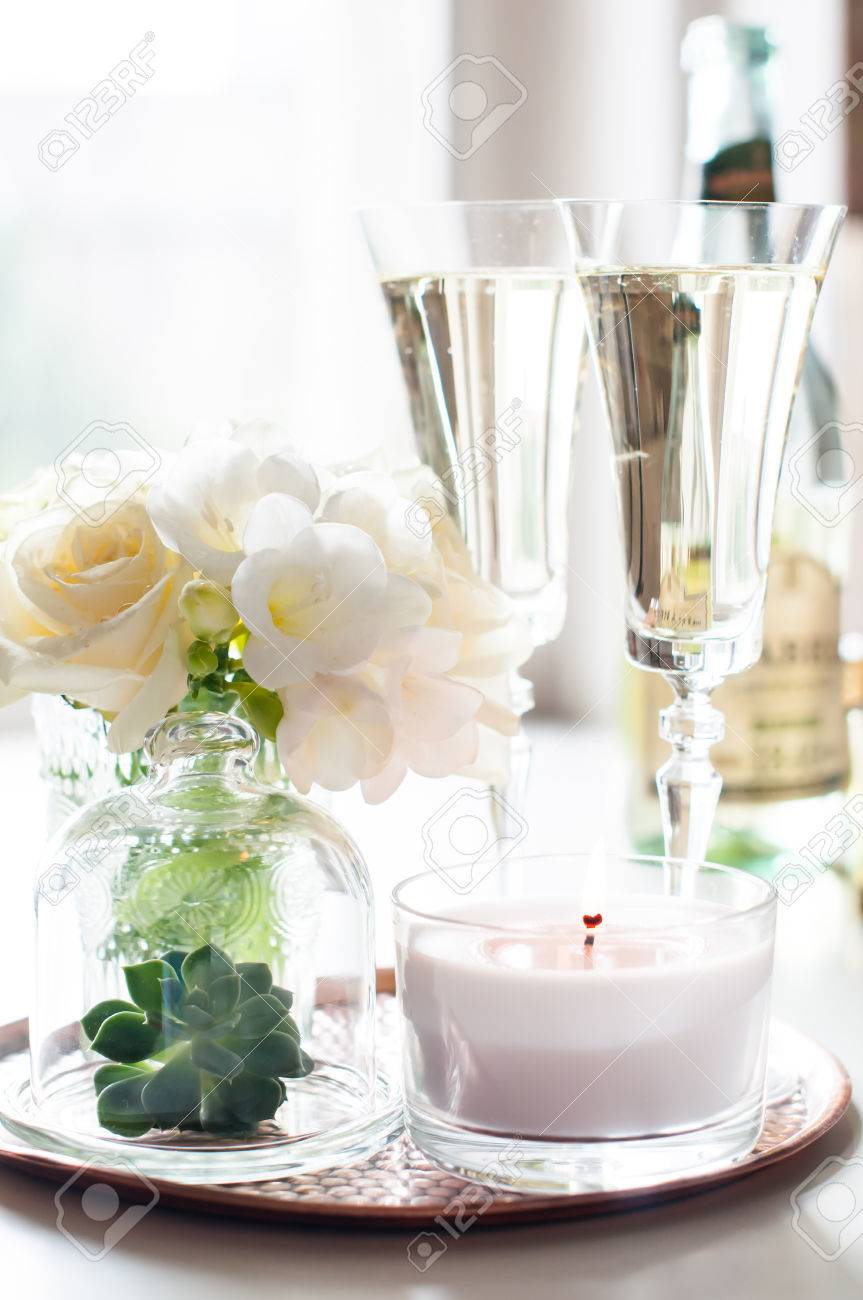 Bouquet Of White Flowers In A Vase, Candles And Champagne On.. Stock ...
