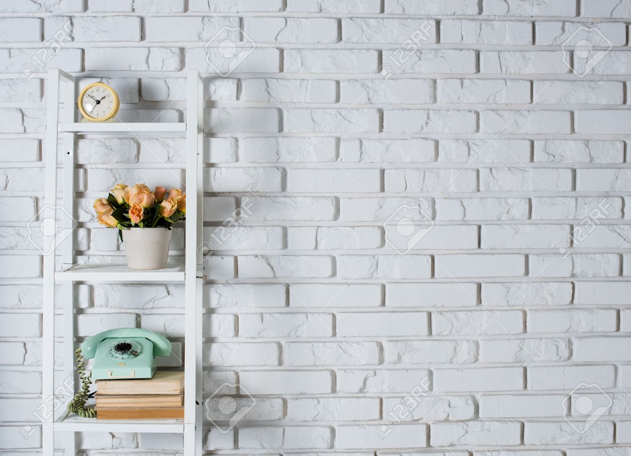 Attractive Shelf With Interior Decoration In Front Of A White Brick Wall, Vintage  Decor Stock Photo