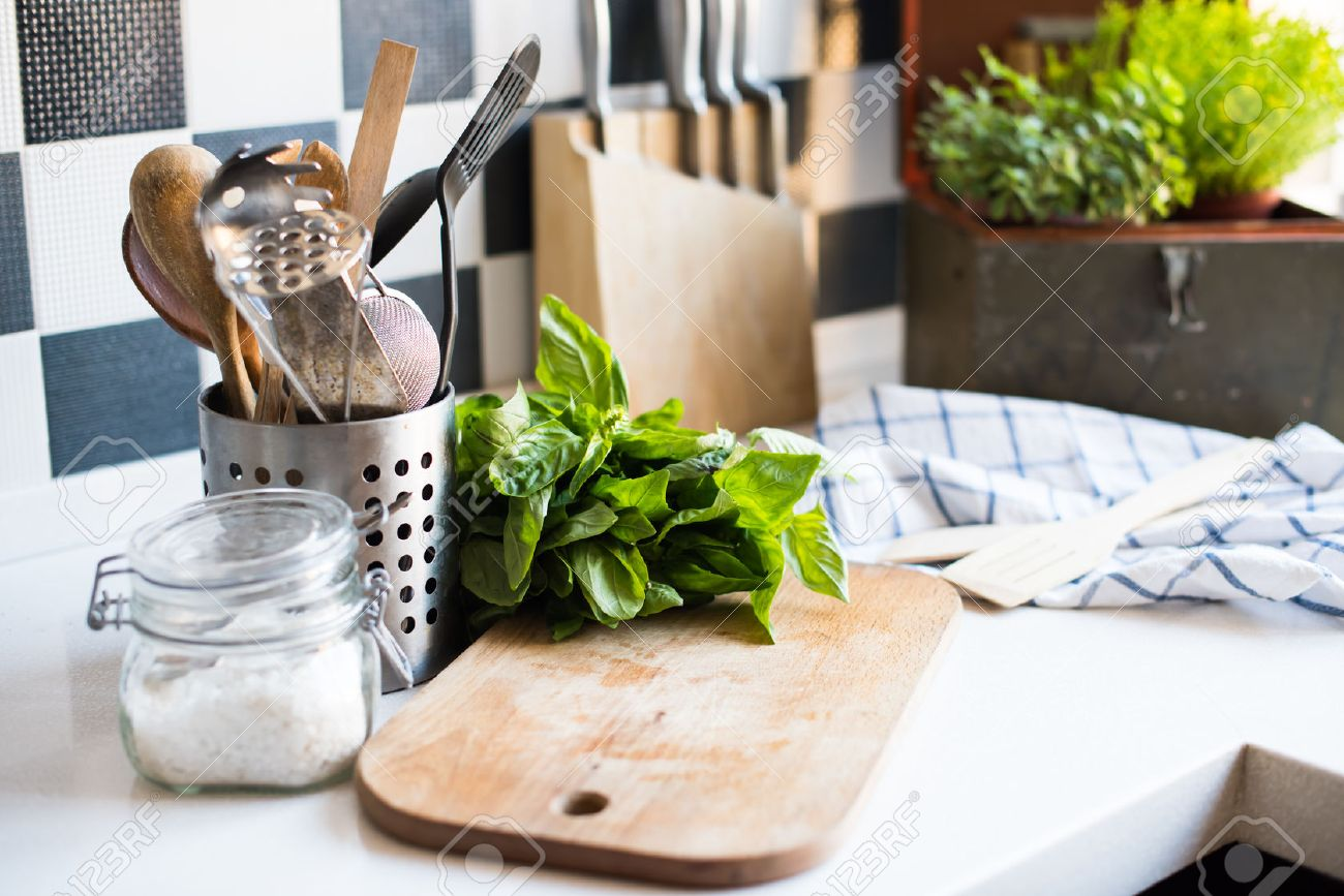A Bunch Of Basil On The Board On The Kitchen Table, Home Kitchen Supplies  For