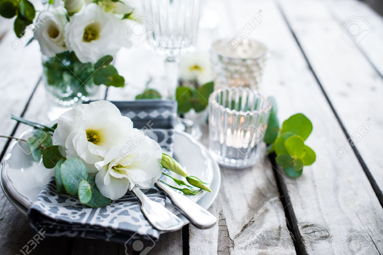 Stock Photo - Table setting with white flowers candles and glasses on old vintage rustic wooden table. Vintage summer wedding table decoration. & Table Setting With White Flowers Candles And Glasses On Old.. Stock ...