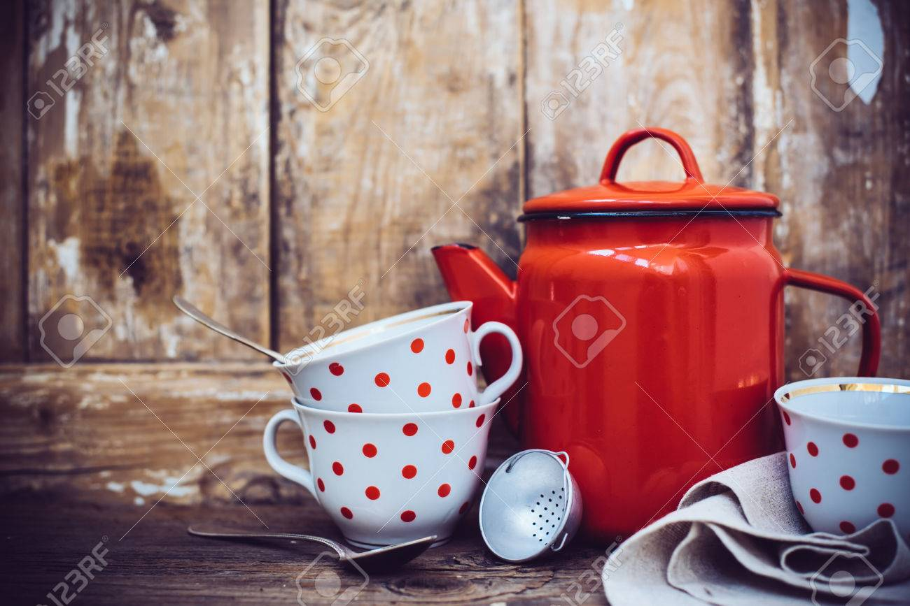 Vintage kitchen decor, red enamel coffee pot and cups with polka..