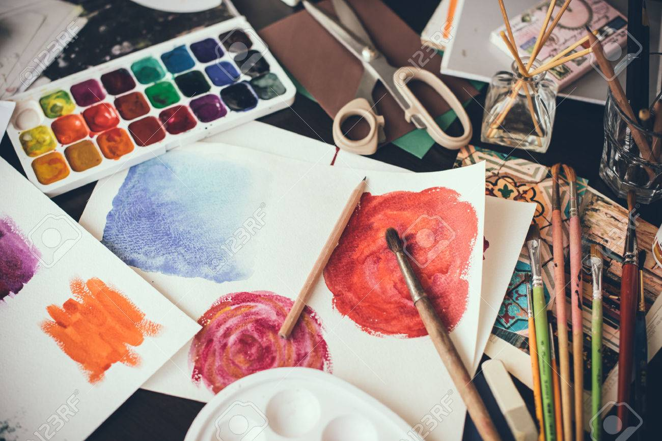 mess in the the studio watercolor paints brushes and sketches palette and