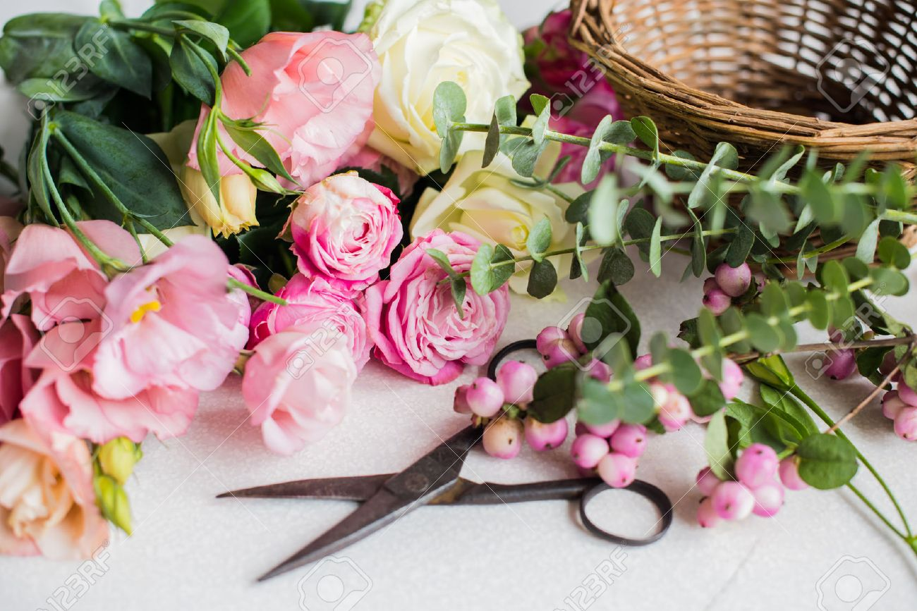 Fresh Flowers, Leaves, And Tools To Create A Bouquet On A Table ...