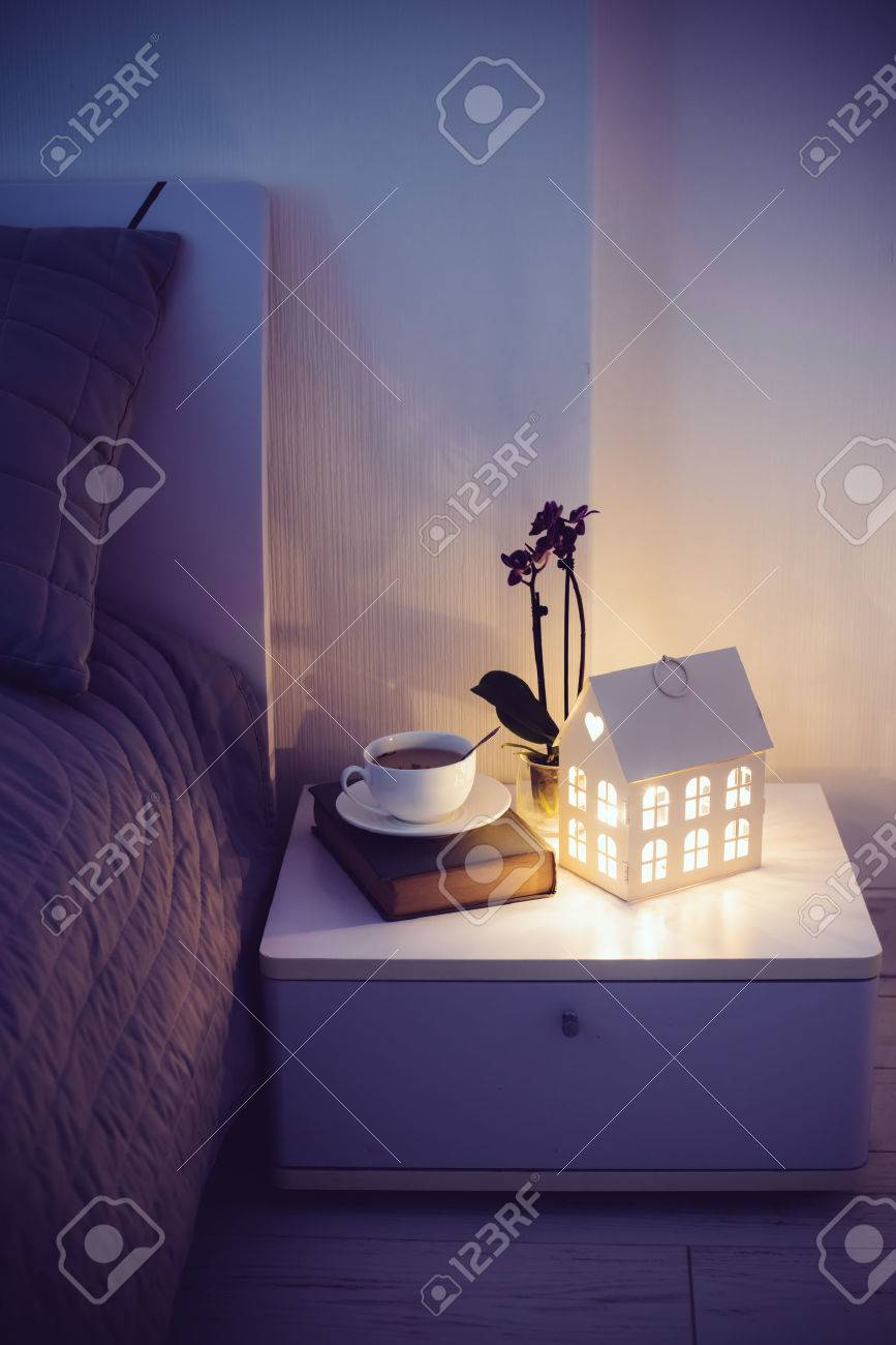 Cozy Evening Bedroom Interior Cup Of Tea And A Night Light On
