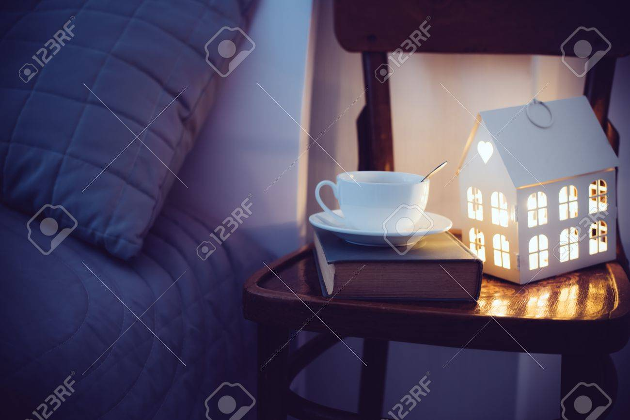 Cozy Evening Bedroom Interior Cup Of Tea And A Night Light On The Bedside Table