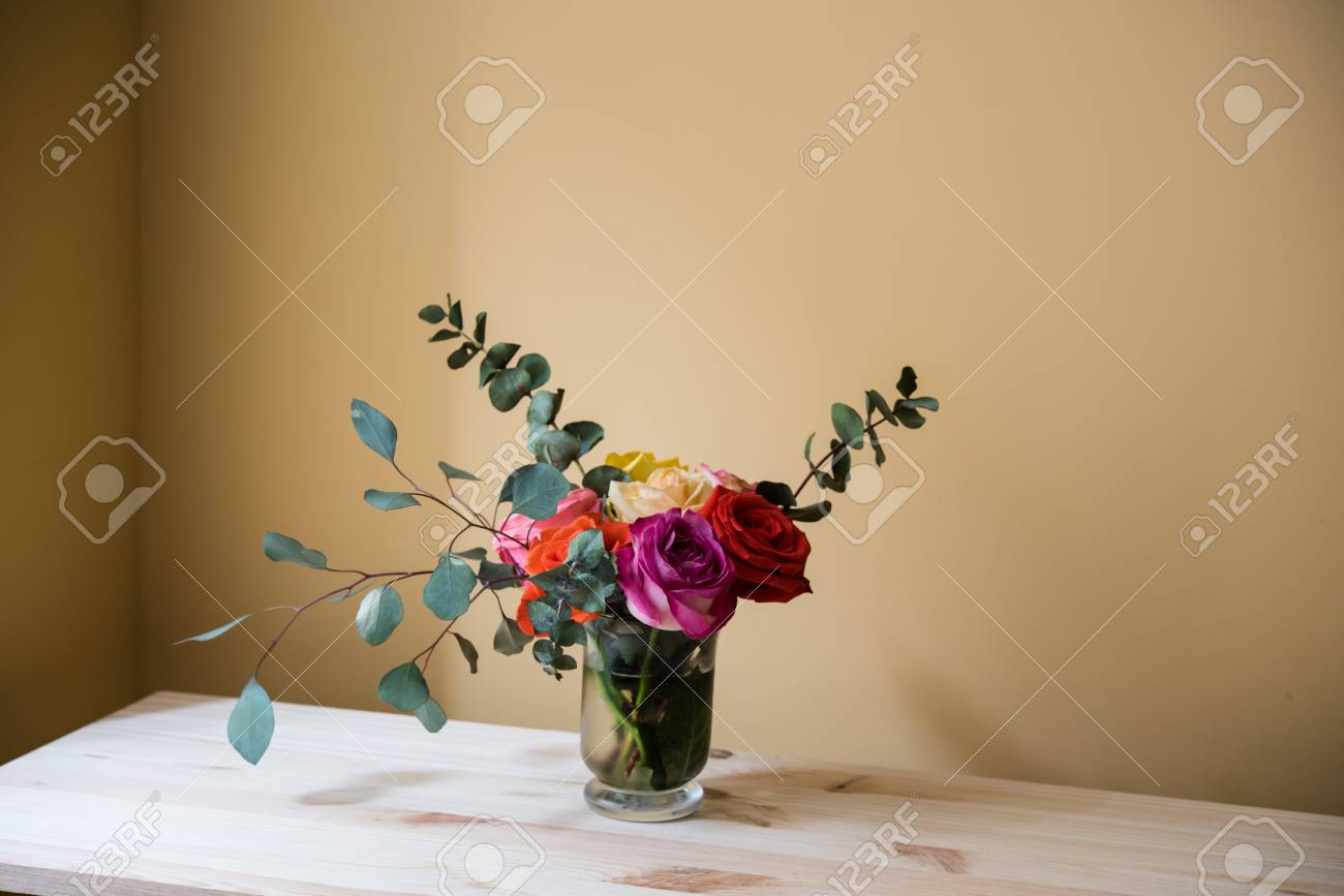 Bouquet Of Colorful Roses In A Vase On The Table, By Tha Wall ...
