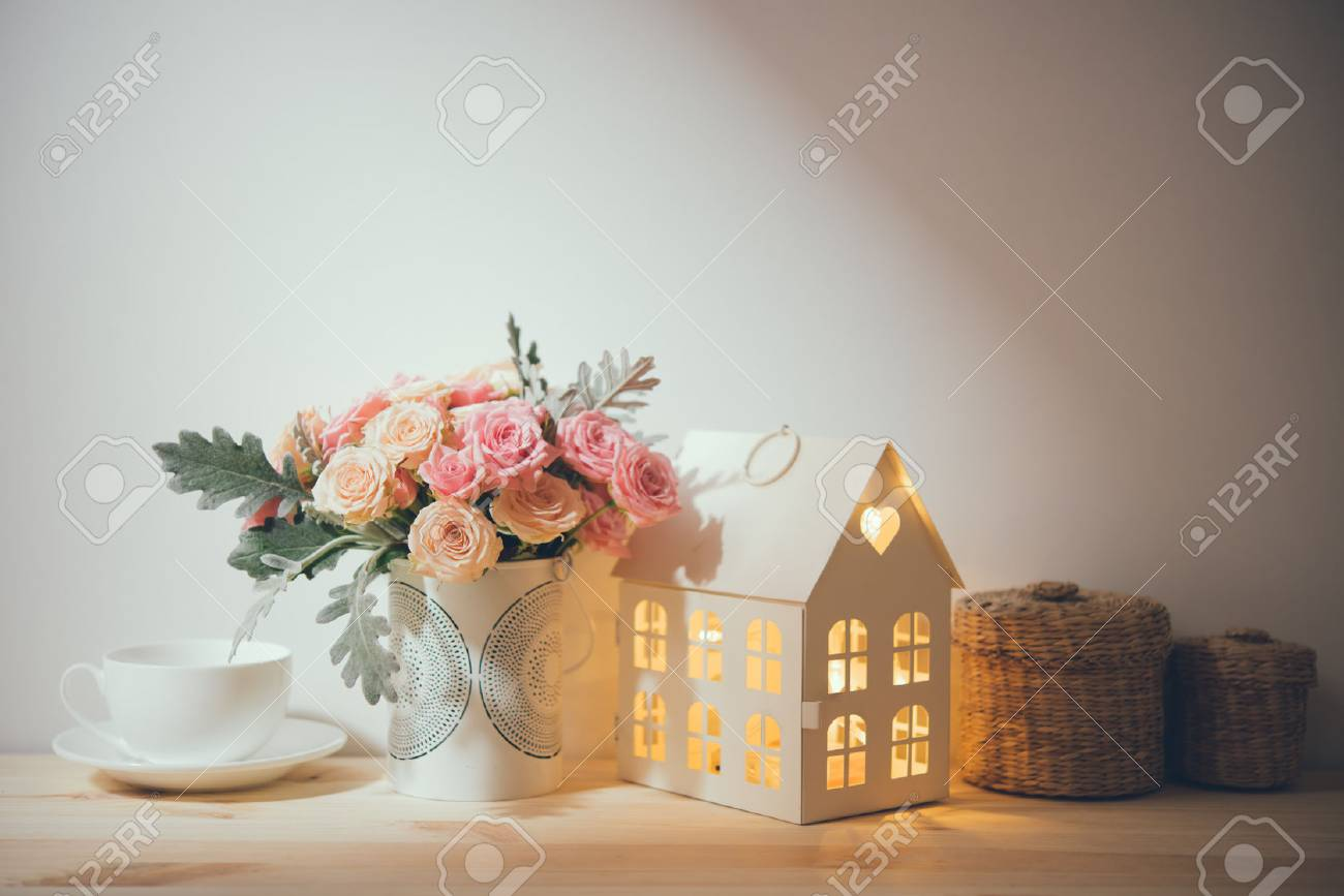 Beautiful Vintage Home Decorations Flowers And Decorative Objects On The Shelf By Wall