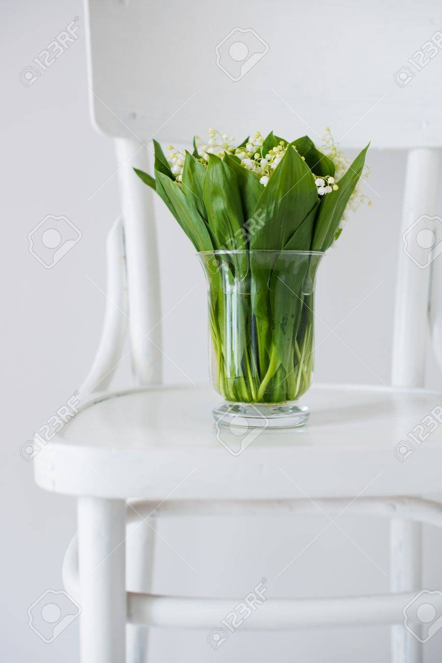 Home Decor Lilies Of The Valley In A Vase On Rustic White Chair