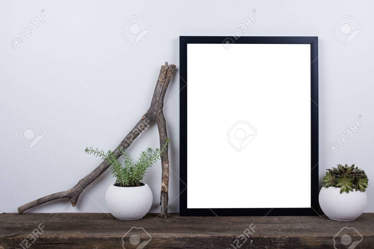 home decor photography. Scandinavian style empty photo poster frame mock up  Minimal home decor on rustic wooden board Style Empty Photo Poster Frame Mock Up Stock