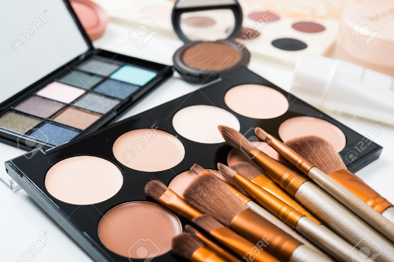 Professional makeup brushes and tools, natural make-up products set, eyeshadows and concealers on white table. - 60728819