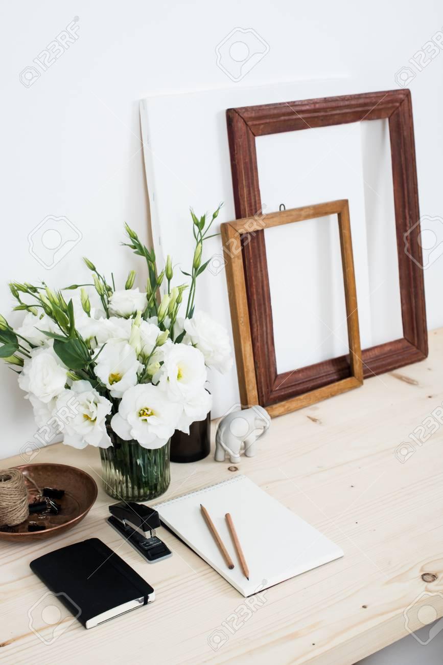 White Contemporary Feminine Work Desk With Flowers, Art Frames ...