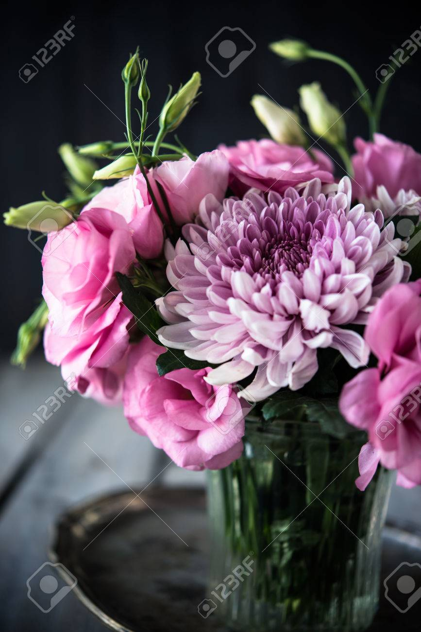 Bouquet of pink flowers in a vase eustoma and chrysanthemum bouquet of pink flowers in a vase eustoma and chrysanthemum elegant vintage rustic home mightylinksfo Gallery