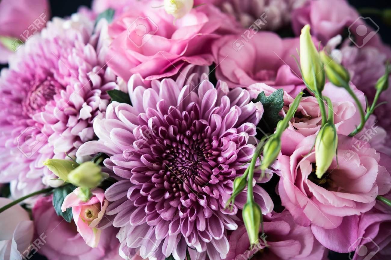 Bouquet of pink flowers closeup, eustoma and chrysanthemum, elegant vintage floral decor - 63736740