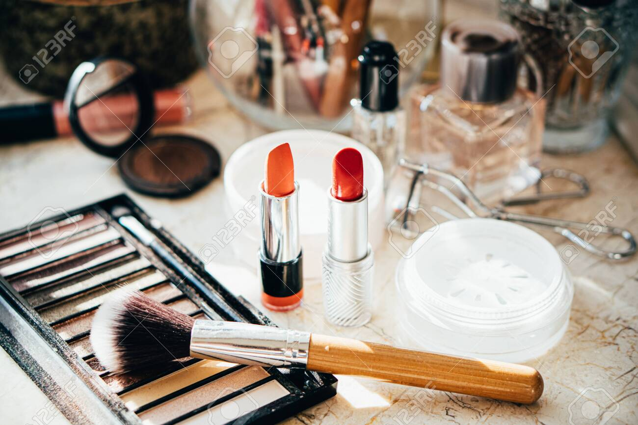 Real professional makeup tools and acessories, brushes and lipsticks on artist's table close-up - 137600202