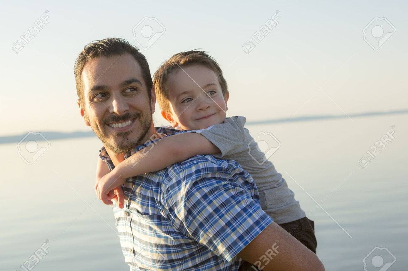 A Father with is son at the sunset - 47497128