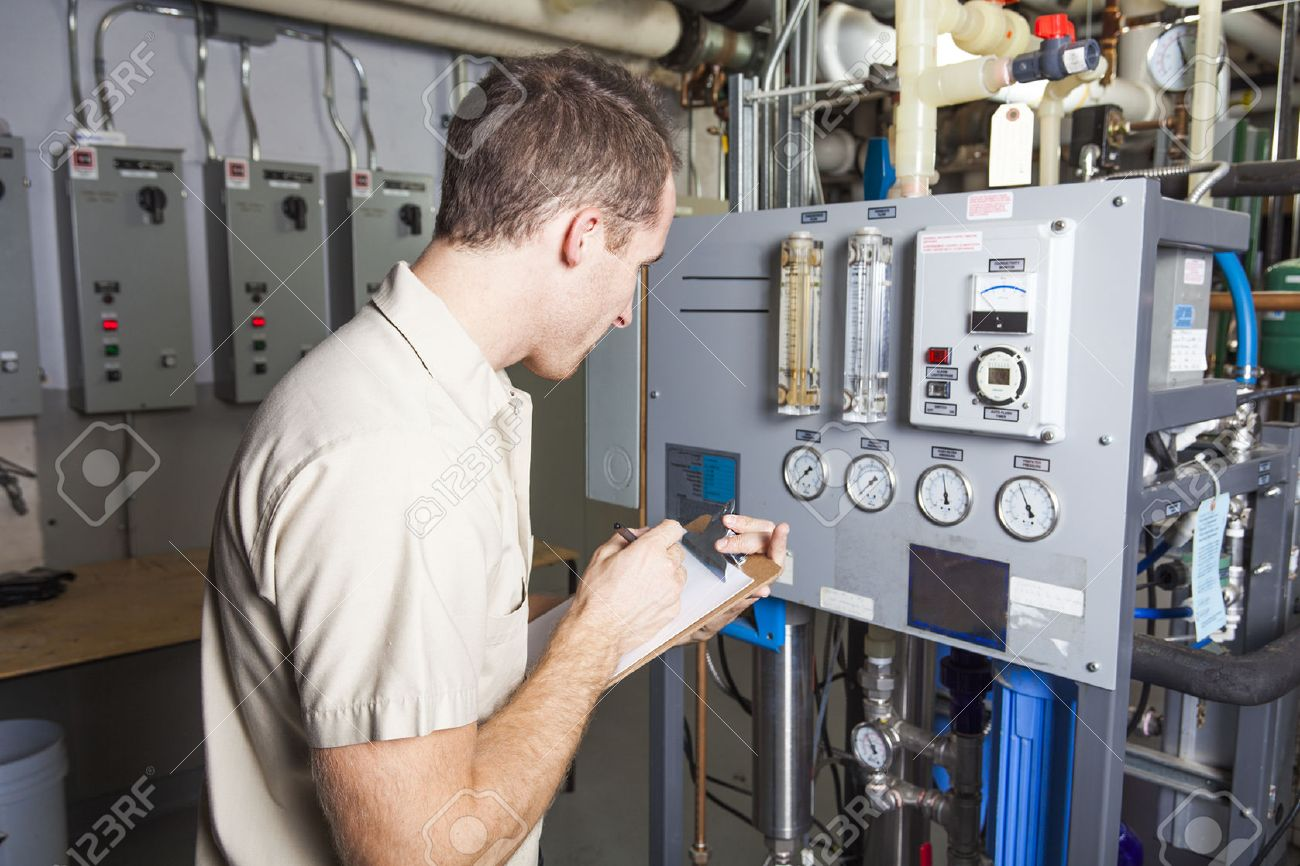 A Technician inspecting heating system in boiler room - 49252193