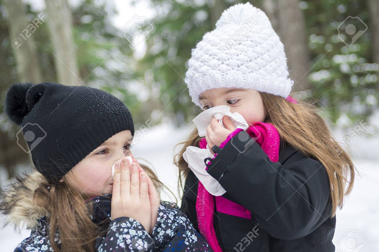 Two childs with tissue outside in forest winter season - 50483669