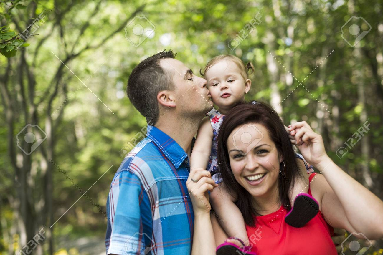 A family with cute baby girl nature in the forest stock photo 61109826