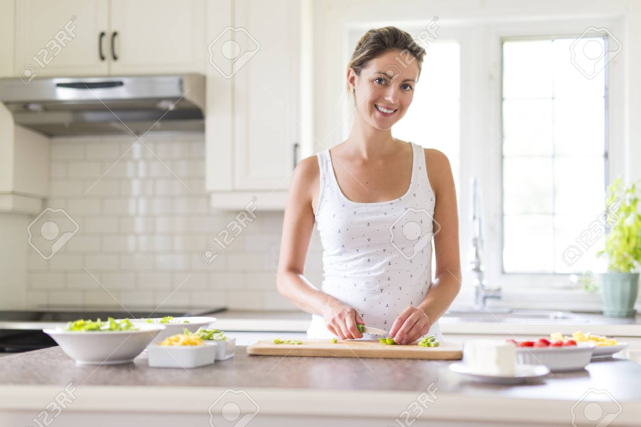 Gorgeous Woman Doing A Salad In Her Kitchen Stock Photo, Picture And ...