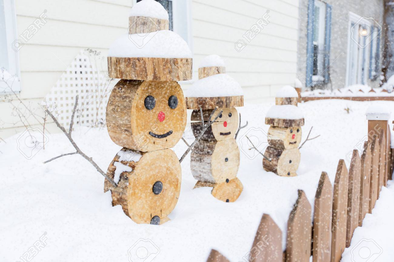 a snowman made in piece of wood with fence on the front stock photo 86686202