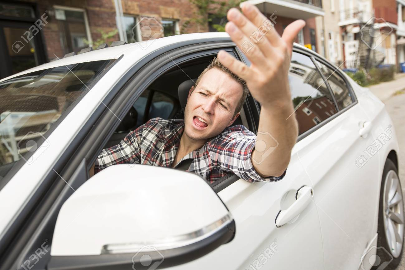 Irritated young man driving a car. Irritated driver - 87165624