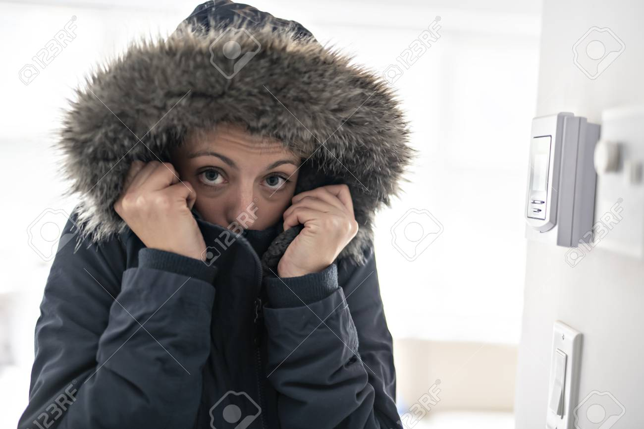 Woman With Warm Clothing Feeling The Cold Inside House - 112330873