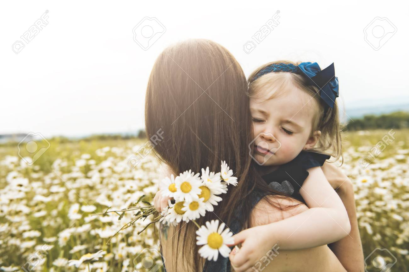 Mother spending time with daughter during the sunset. - 112596088