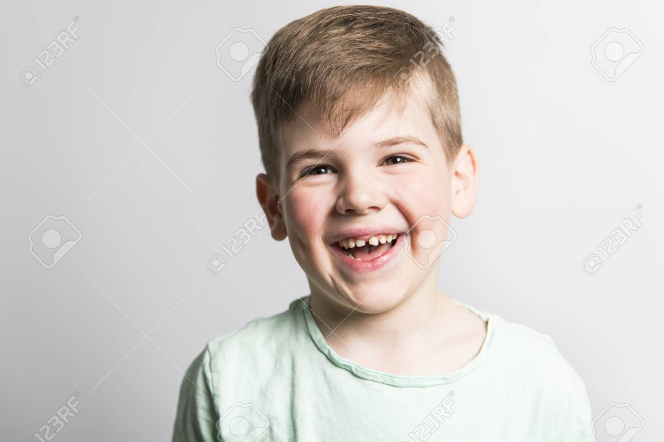 five year old boy posing over white studio background - 112689157