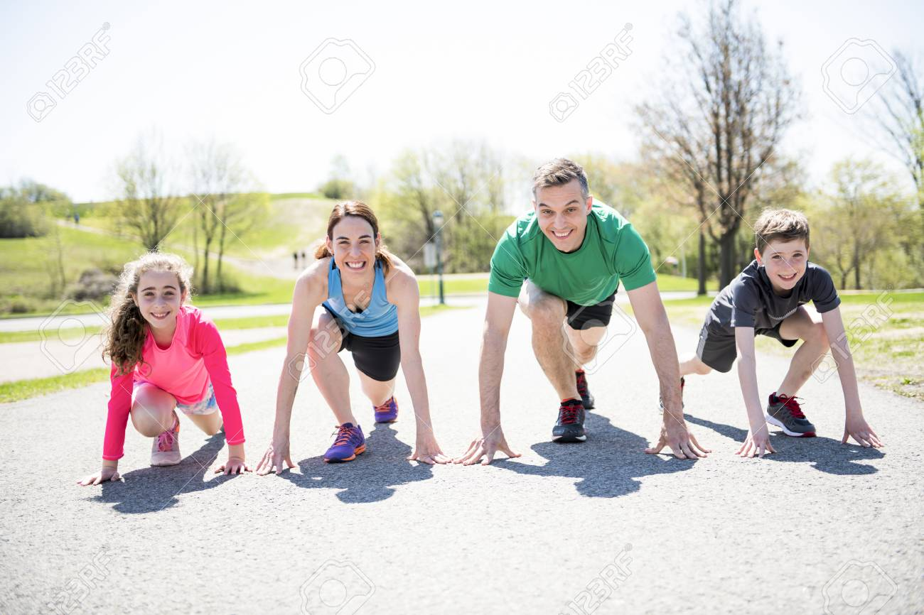 Parents with children sport running together outside - 112727310