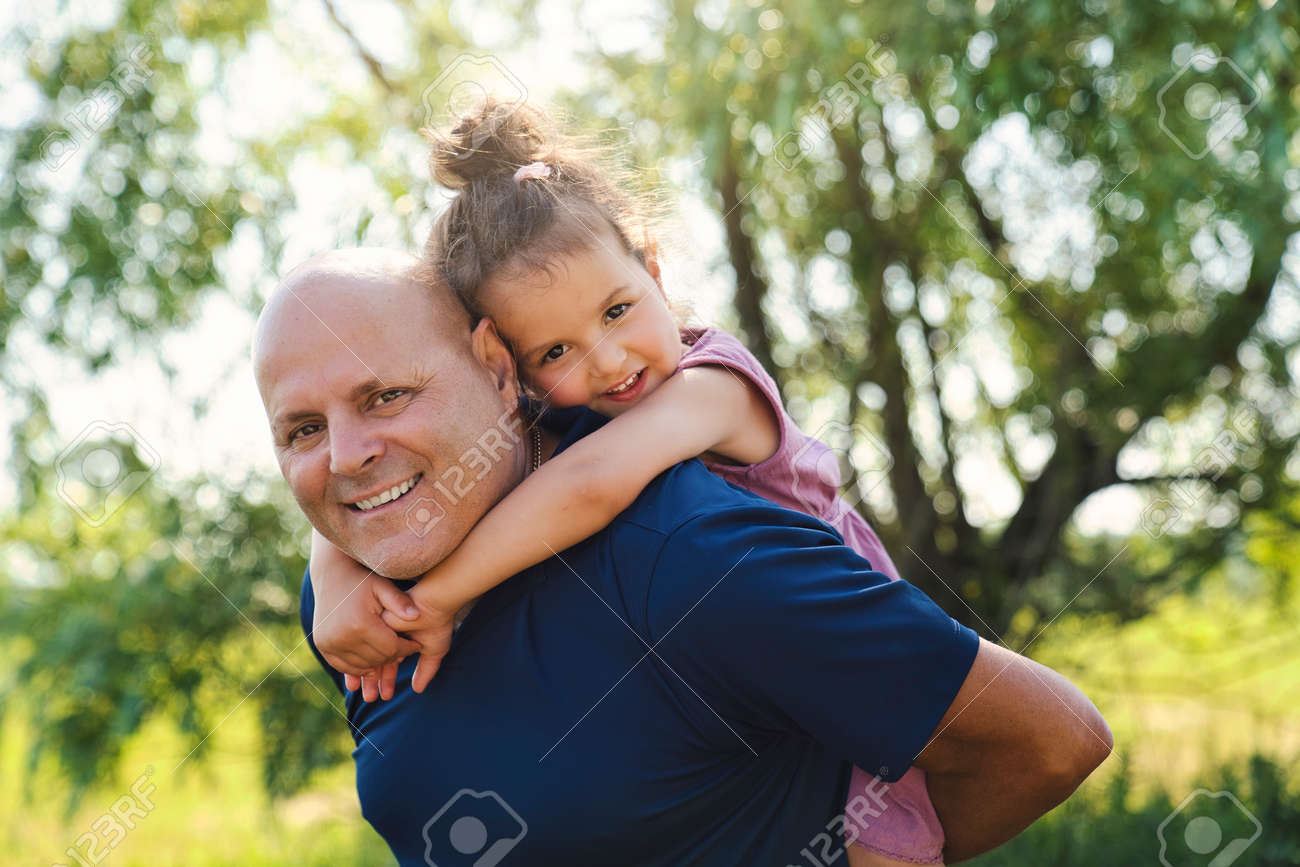 grandfather spending time with littledaughter during the day - 157621086
