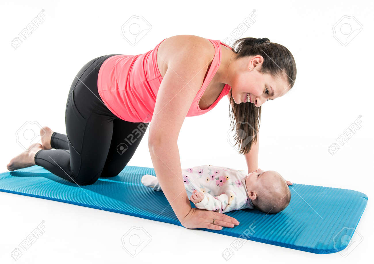 Sport motherhood and active lifestyle of young mother workout together with her baby - 158028478