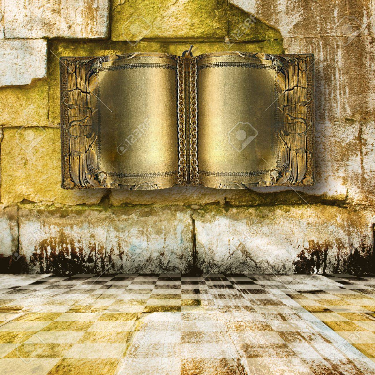 Old ancient book with gold pages on the stone  wall in castle Stock Photo - 8099622