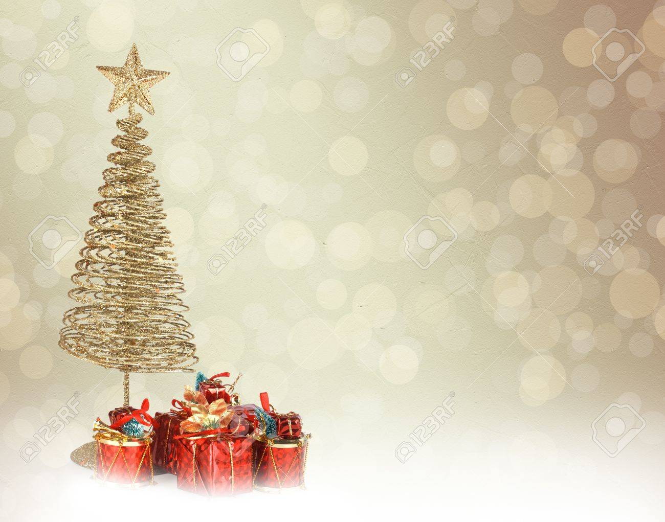 Christmas greeting card with gold metal firtree and presents on the abstract background Stock Photo - 16270409