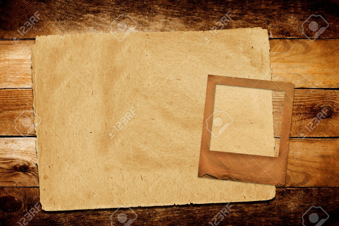 old grunge paper slide on the wooden background stock photo picture