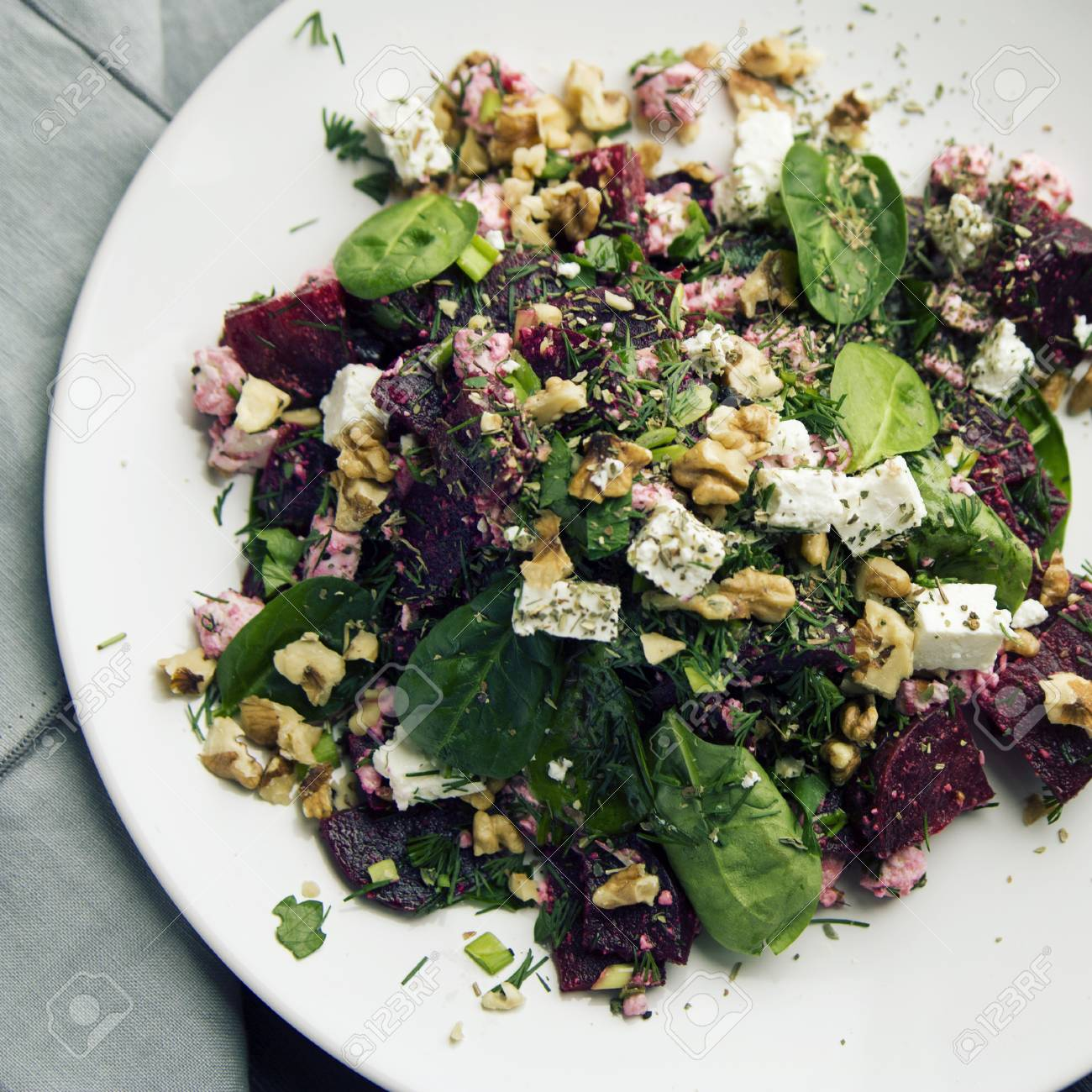 Beetroot Salad With Cottage Cheese Baby Spinach And Walnuts Stock Photo Picture And Royalty Free Image Image 100087201