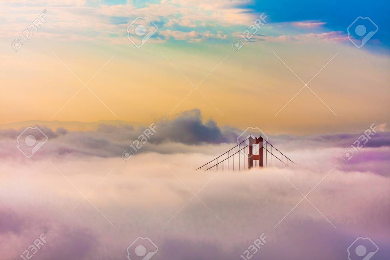 World Famous Golden Gate Bridge Surrounded by Fog after Sunrise in San Francisco,California - 20900287