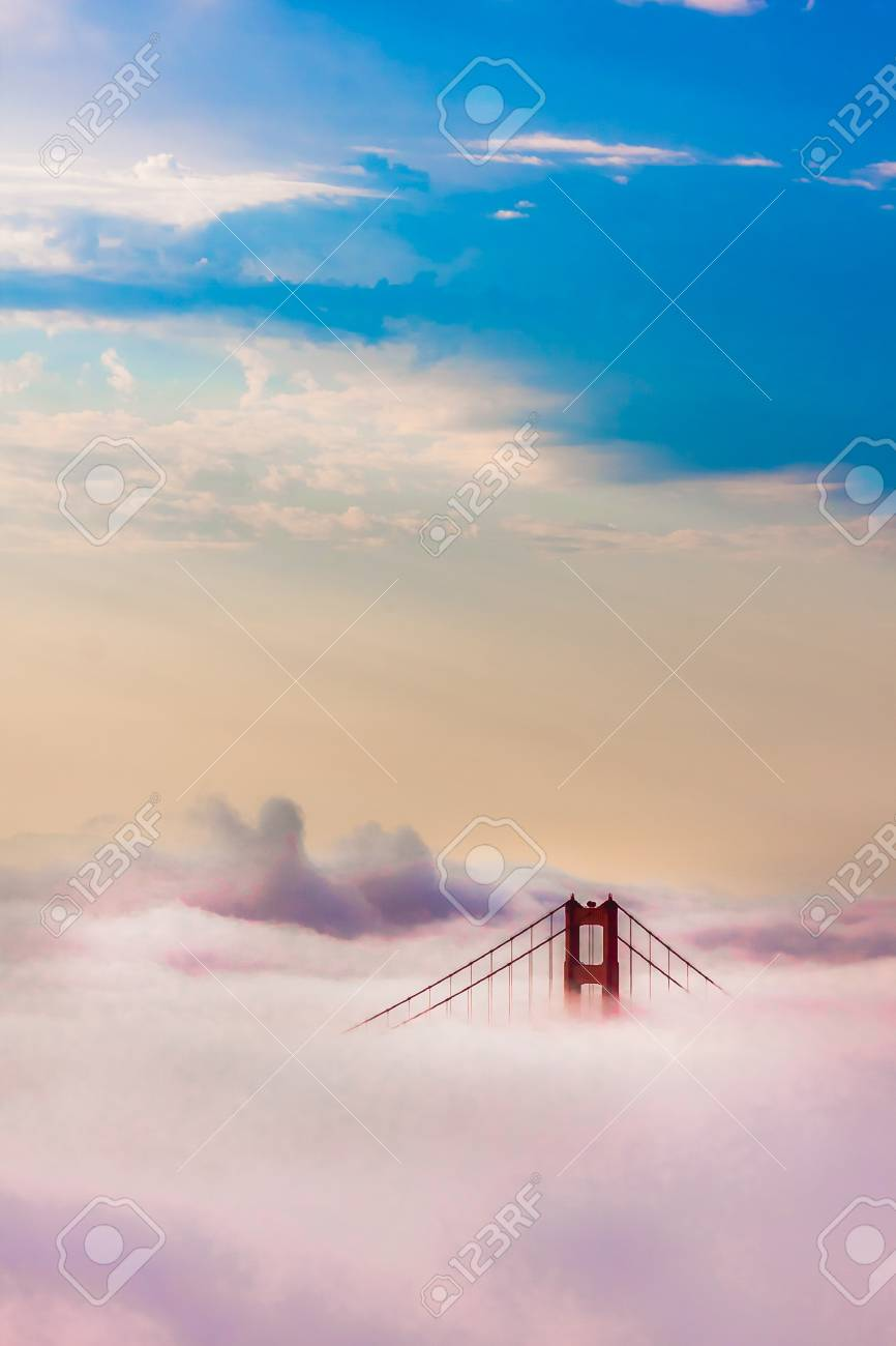 World Famous Golden Gate Bridge Surrounded by Fog after Sunrise in San Francisco,California - 20880659